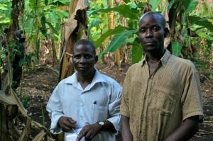 Farmers Eias Hasalube and Hakin Aziz beneath the canopy of Mr. Aziz's restored coffee farm.