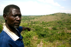 Nathan Watadena points to land that is targeted for reforestation and restoration.